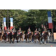 Défilé de la fanfare du régiment de cavalerie de la Garde républicaine sur les Champs-Elysées, lors du 14 juillet 2018 à Paris.