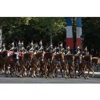 Défilé du régiment de cavalerie de la Garde républicaine sur les Champs-Elysées, lors du 14 juillet 2018 à Paris.