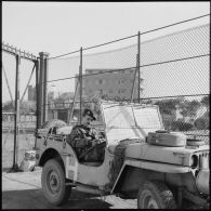 Prise d'armes sur l'embarcadère du ferry et rembarquement des troupes françaises à Port-Fouad.